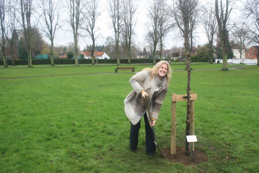 Cindy Sutherland helps plant a tree in Wyndham park, Grantham. in memory of her mother Jenny