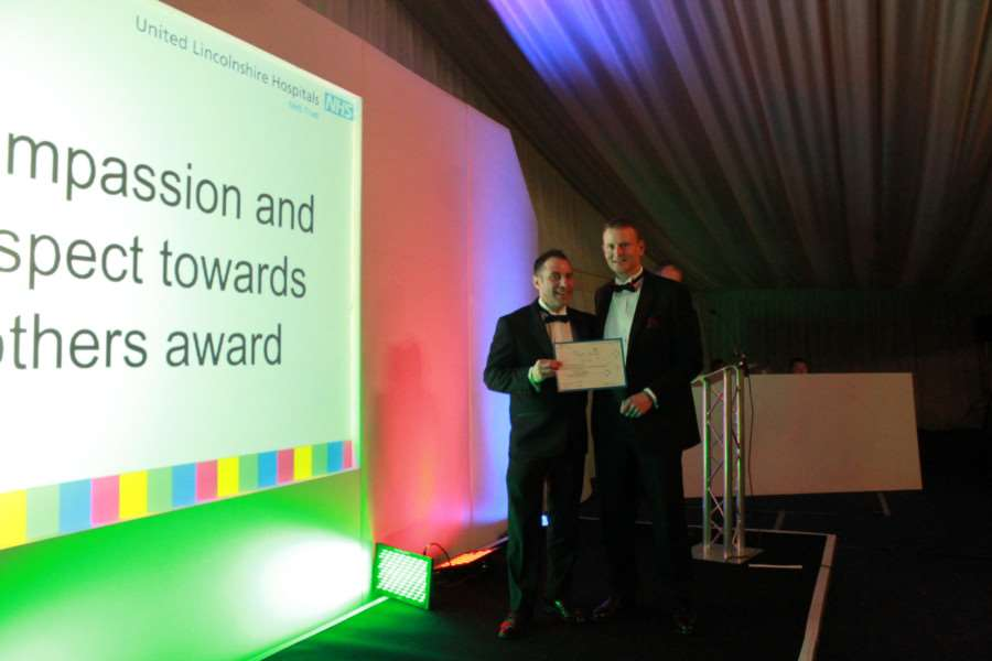 ULHT awards: Compassion and Respect Award - highly commended Grantham porter Kevin Young with director of estates and facilities Paul Boocock