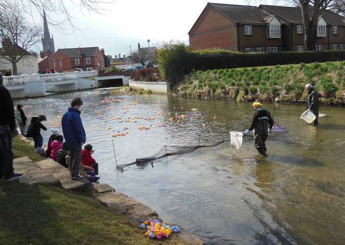 Grantham Kesteven Rotary Club holds its annual duck race on the River Witham.