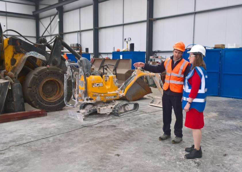 Mid UK MD Chris Mountain and Dr Caroline Johnson MP in the new workshop at Barkston Heath.