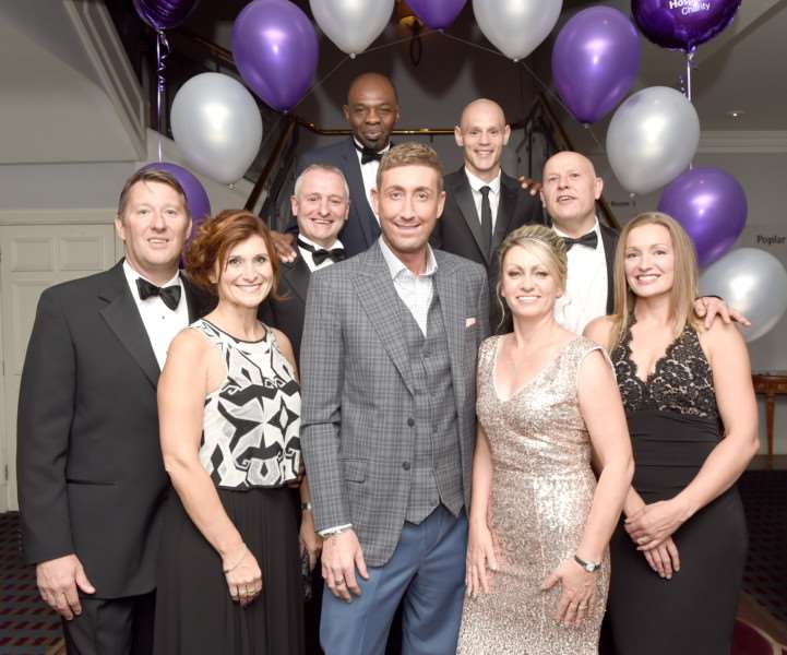 Attending the Naomi ball at Belton Woods Hotel were, from left, front row: Martin and Marie Watson, Chris Maloney ( X Factor, Celebrity Big brother), Michelle Fardell and Heather Brown; middle row: Dean Fardell and Ben Benbow; back row: former British Commonwealth and European Super Middleweight boxing champion James Cook MBE and Kevin Super Hooper, former English Lightweight Champion.