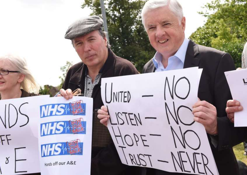 Coun Ray Wootten, right, protested at a rally outside Grantham Hospital, over the reduction in A&E cover in Grantham.