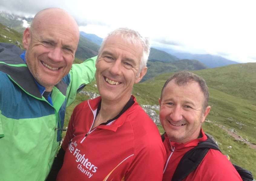 Finished! Grantham firefighters Craig Baillie and Kyle Campbell are joined by support team member Craig Tuck, left, to celebrate their completion of the Three Peaks Challenge.