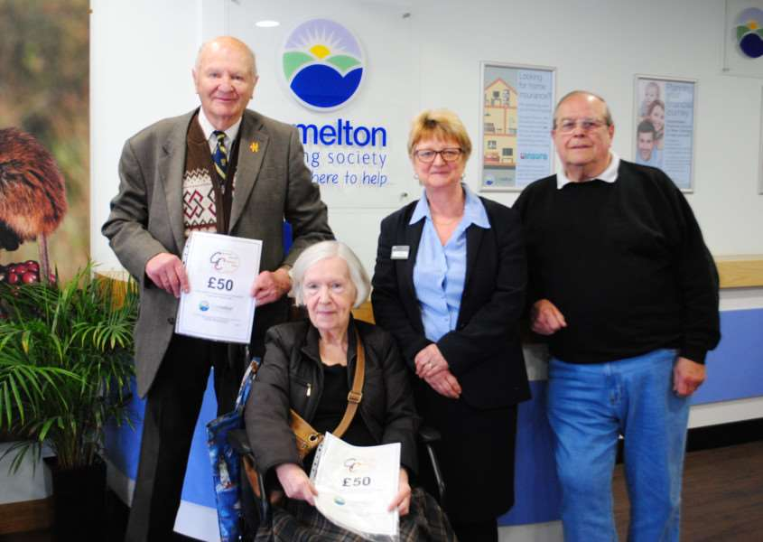 Pictured, from left, are Heavens Above competition winners Vic Heppenstall and Irene Goodge, with The Melton's Dawn Wright and Grantham Journal Children's Fund chairman Roy Wright.