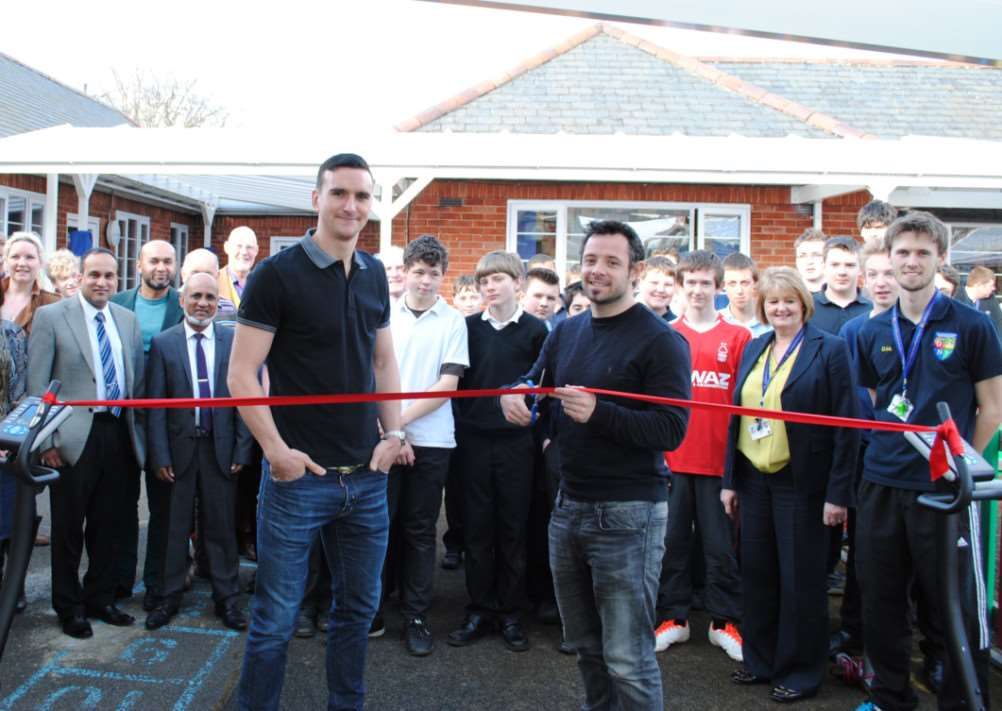 Nottingham Forest players Jack Hobbs, left, and Andy Reid, open the new gym at Ambergate School in Grantham.