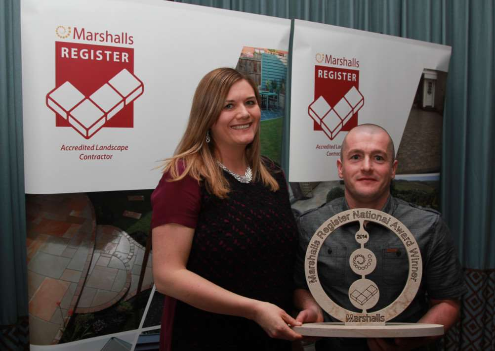 Marshalls' Claire Quinton-Tulloch presents the award to Brian Harrison of BH Building.