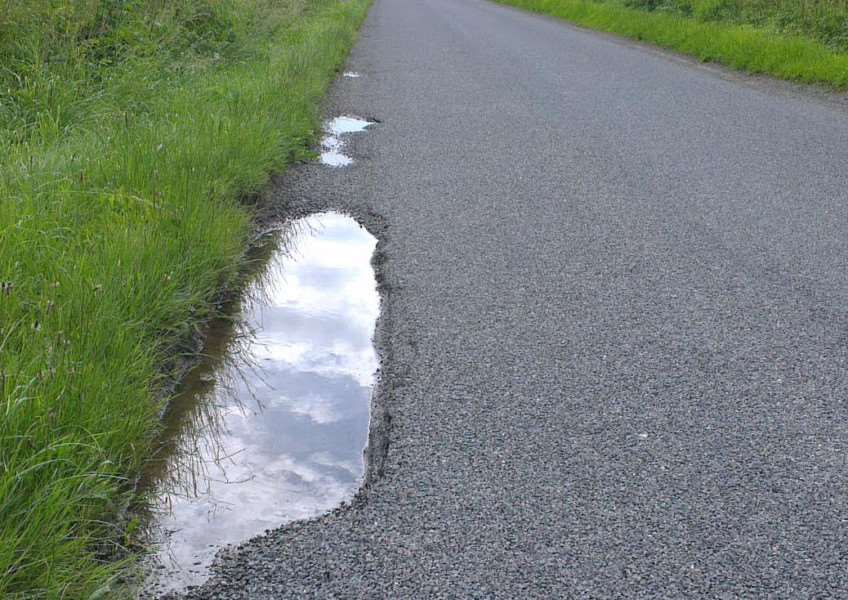 Potholes have formed along the road leading from the A52 to Ropsley. Photo: Derek Hindley