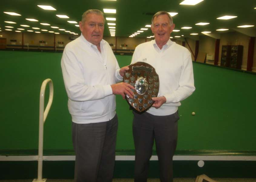 Rob Miller receives the Gala trophy from Sencit chairman Len Payling.
