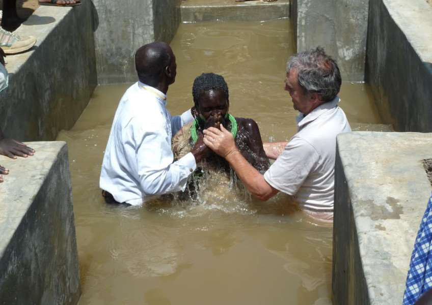 Ken baptises a woman in South Sudan - among 240 in a weekend.