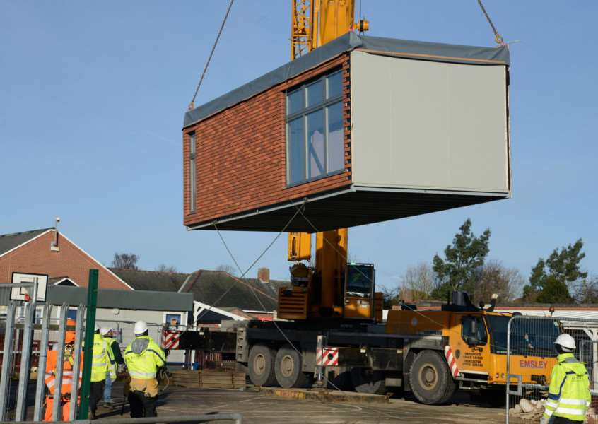 A new classroom at Ambergate is craned in.