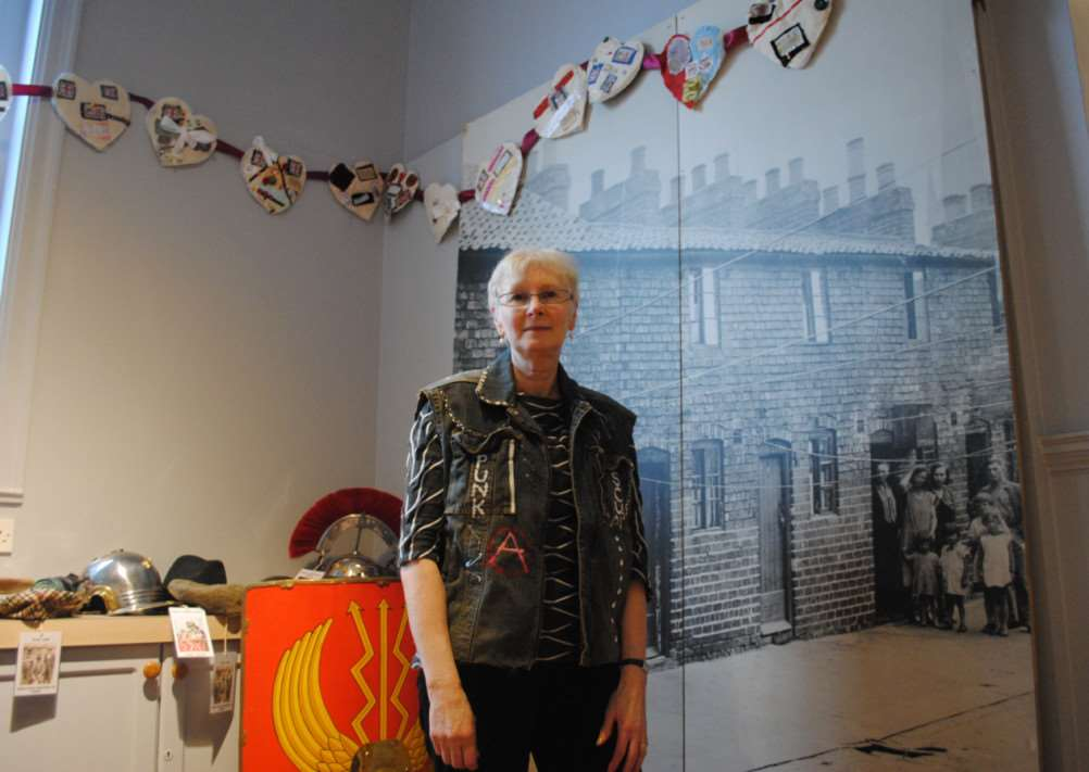 Exhibitions director Christine Robbins wears a punk jacket in the dressing up area at Grantham Museum.