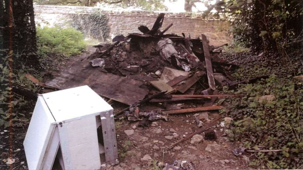 A Grantham company was fined after these fire-damaged items were dumped near the Belton House estate.