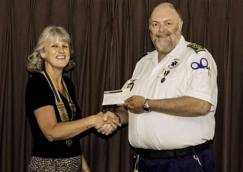 Rod from the Vale Community Responders receives a cheque from Rotary Club of the Vale of Belvoir president Jennie Henley.