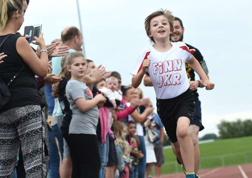 Over 50 supporters cheered Finn on as he ran his final mile on Monday.