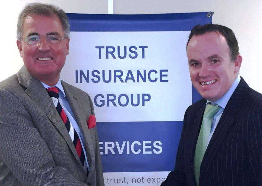 Keith Horton (left), chief executive of Grantham Town with Stuart Pigram, group sales director of The Trust Insurance Group.