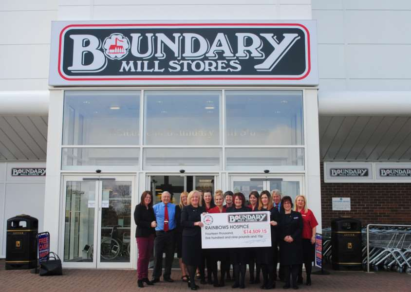 Fund-raising staff at Boundary Mill present their generous cheque to Katie Baxter of Rainbows, left.
