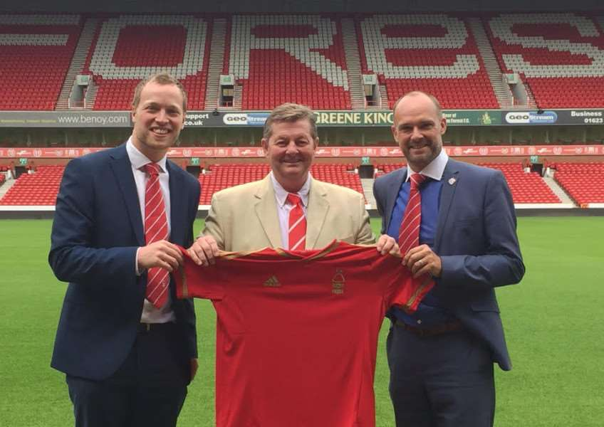 Nottingham Forest director David Dunne, centre, with Robin Campbell, sales manager, and Simon Fotheringham, commercial manager.