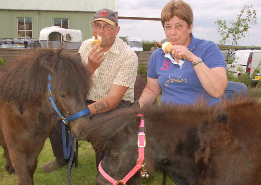 Scott StClair and Denise Baker enjoy ice cream with their miniature Shetlands Norman and Nancy 'PHOTO: Tim Williams EMN-160516-163728001