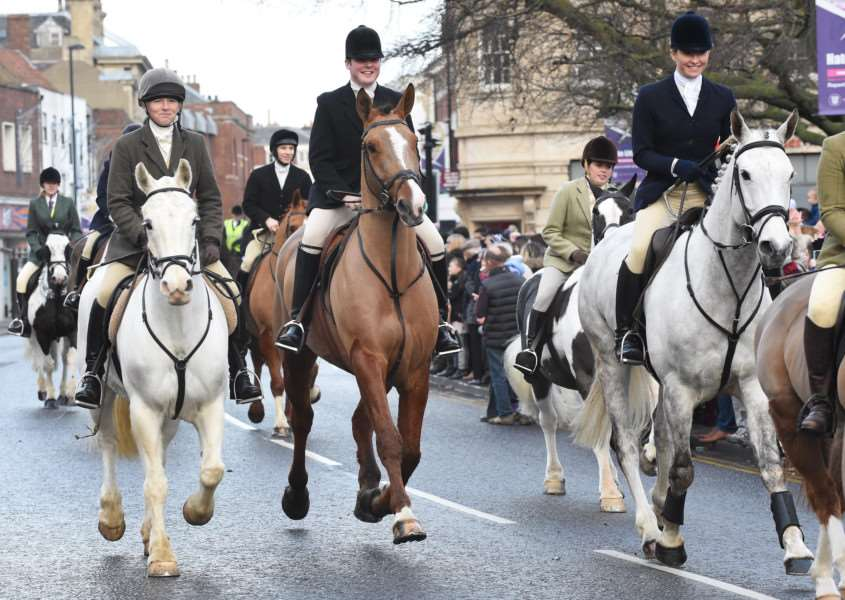 Members of the Belvoir Hunt ride through Grantham. EMN-160501-165918001