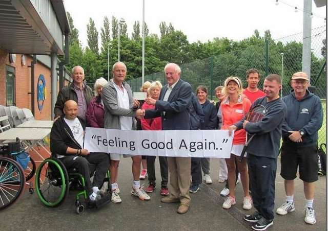 Freemason Jeff Thompson presents a cheque for �400 to Dale Wright, organiser of the Feeling Good Again.. scheme at Grantham Tennis Centre.