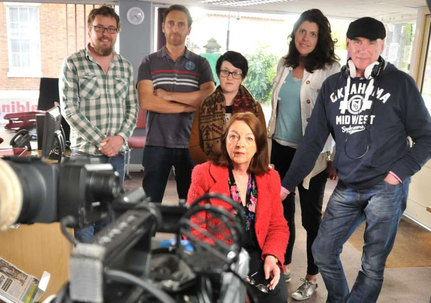 Reporter Lynne Harrison (seated) with members of the crew filming for CBS Reality. SG280415-112TW