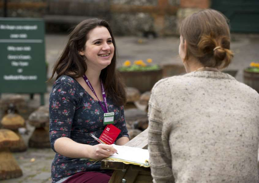 A National Trust volunteer talks to a visitor. Photo: National Trust/John Miller.