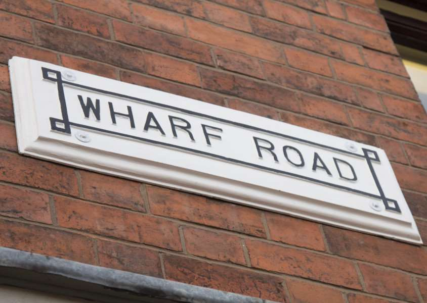 The Wharf Road sign, restored by Gordon Beech, at John Kinnersley's barber shop.