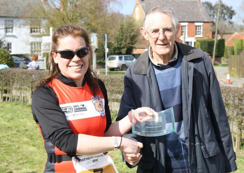 Catherine Davies receives her first lady award at Stathern Duathlon.