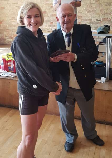 Catherine Payne presented with her Age Group prize at the Thorney Five Mile Road Race on Sunday. Photo: Matthew Kingston-Lee