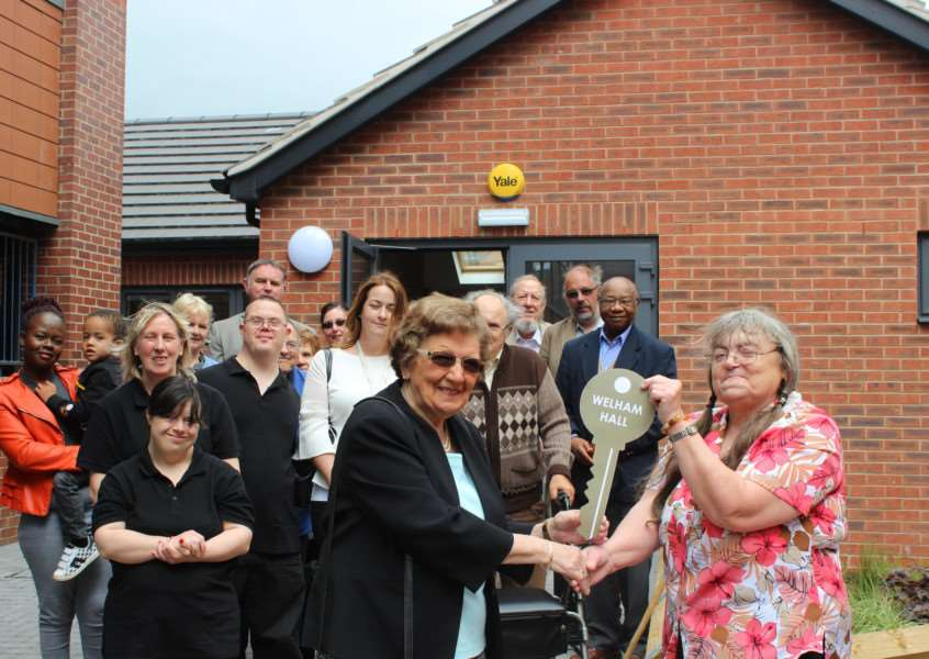 Coun Jacky Smith hands over the new building, Welham Hall, to chairman of Grantham Senior Citizens Club Sandra Bird.