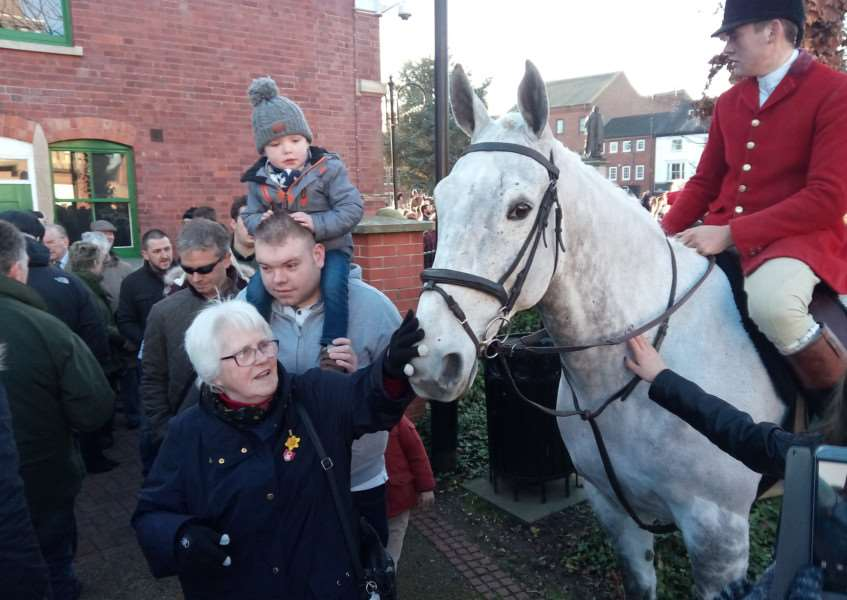 A welcome for the horses of the Belvoir Hunt which met in St Peter's Hill, Grantham, on Boxing Day.