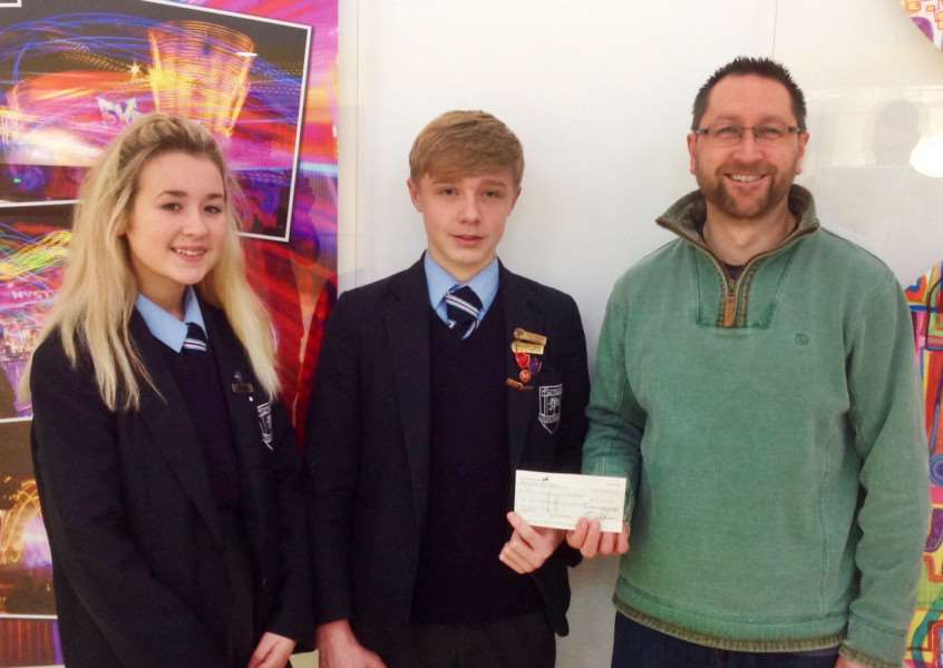 Students from Priory Ruskin Academy present Andy Maddison, from The Grantham Passage, with a cheque for more than �1,000.