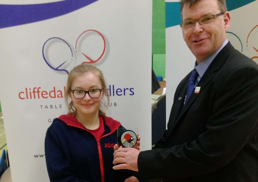 Alexandra Robinson receives her runner-up trophy from Cliffedale Chandlers club chairman Darran Leete.
