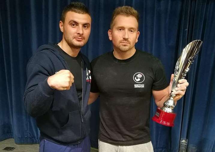 Pictured with James is Viorel Dobrin, the Romanian European champion at 80kg, who presented him with his trophy.