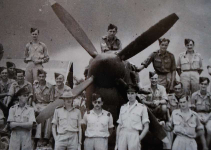 Members of the 152 (Hyderabad) Spitfire Squadron. Photo taken in September 1944 at R.A.F. Tulihal, Imphal, Manipur, India. Ray is seen sitting in between the propeller blades, shortly after his promotion to Sergeant.