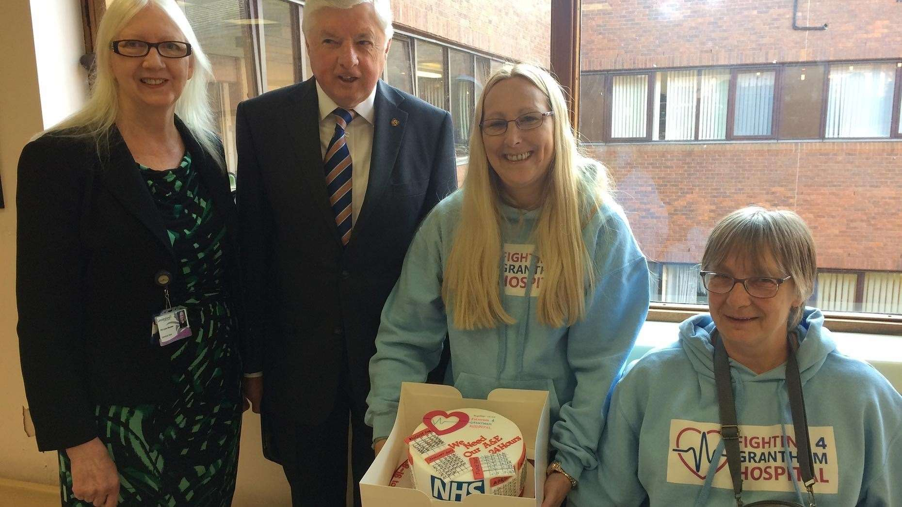 Cake delivered to Lincolnshire helath chiefs to mark 1,000 days since the closure of Grantham's A&E department. (9786467)