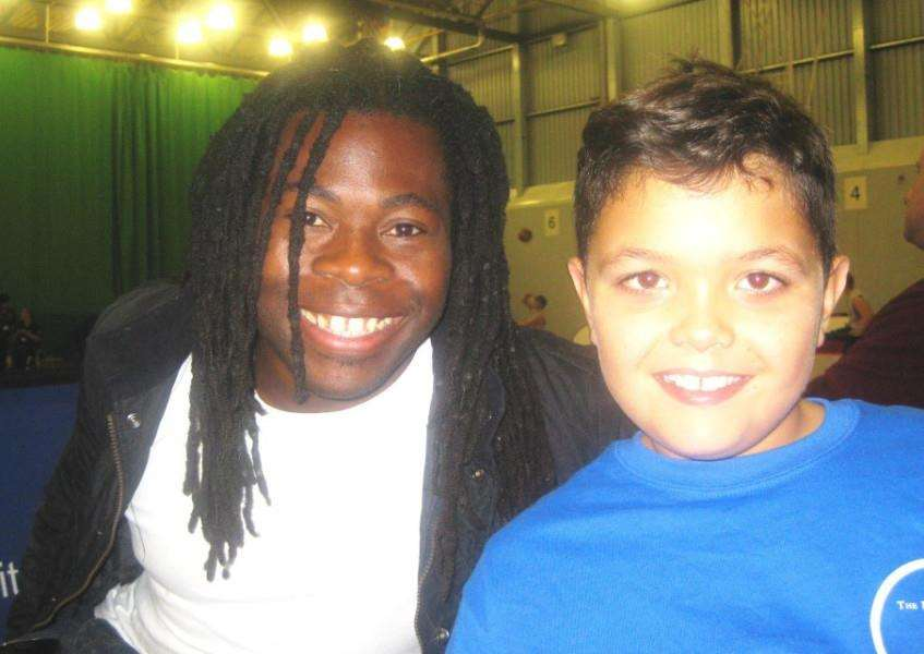 Grantham teenager Luke Holland, with TV presenter and former Paralympic GB wheelchair player Ade Adepitan, who is trying to raise �4,000 for a specialised wheelchair to compete in the sport EMN-161209-101958001