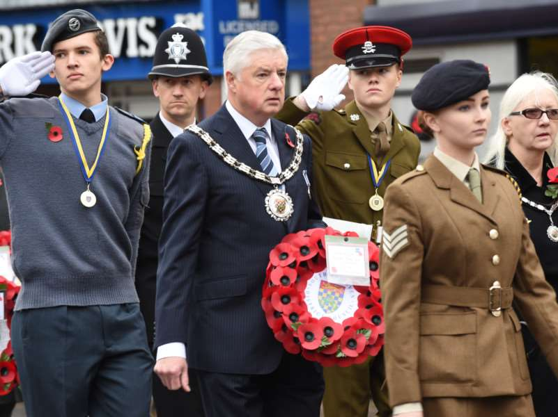 Chairman of South Kesteven District Council Ray Wootten carries a wreath in the Remembrance Day Parade through Grantham. Photo: 626A