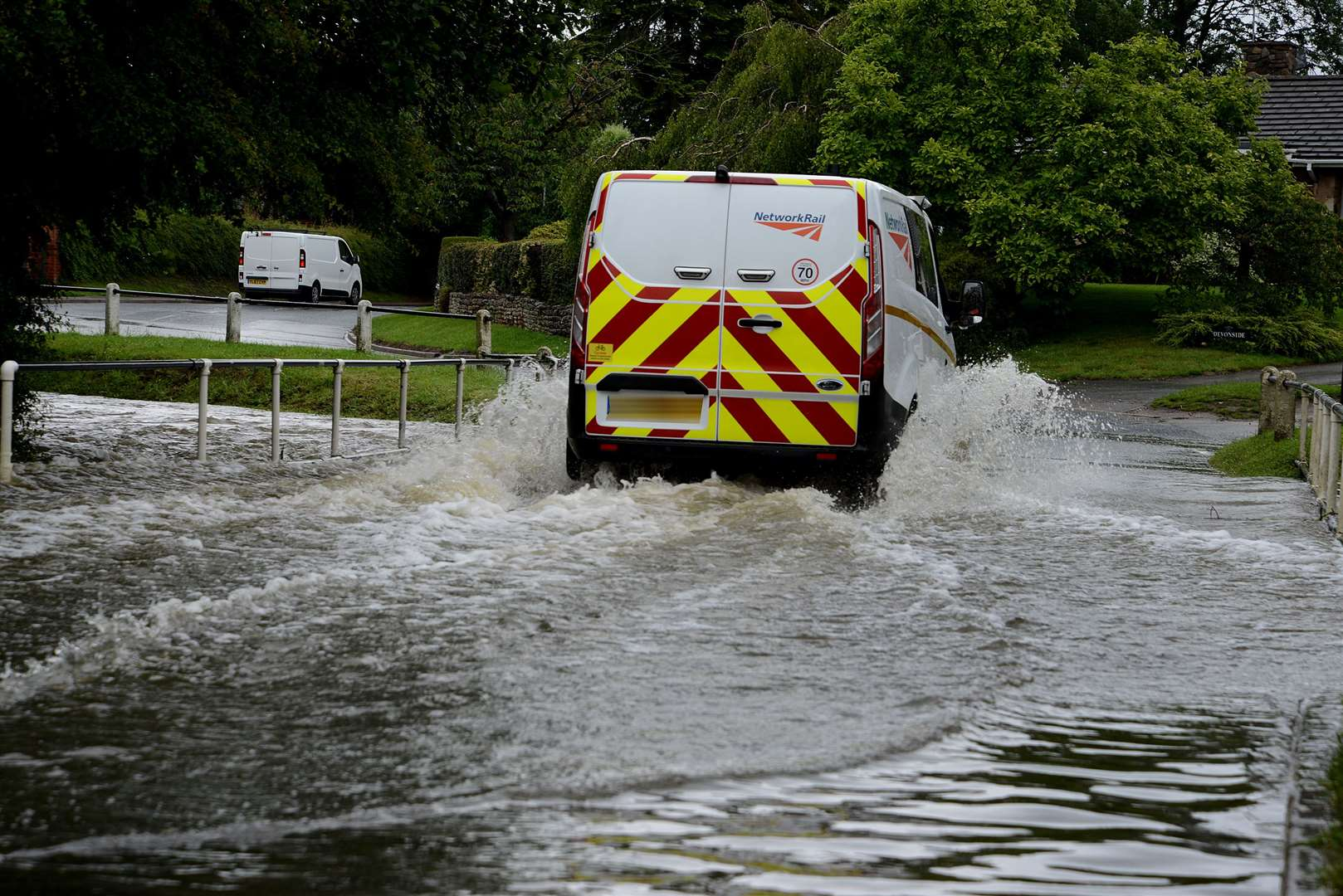 Drivers gingerly made their way through flood waters in Bottesford. (12284798)