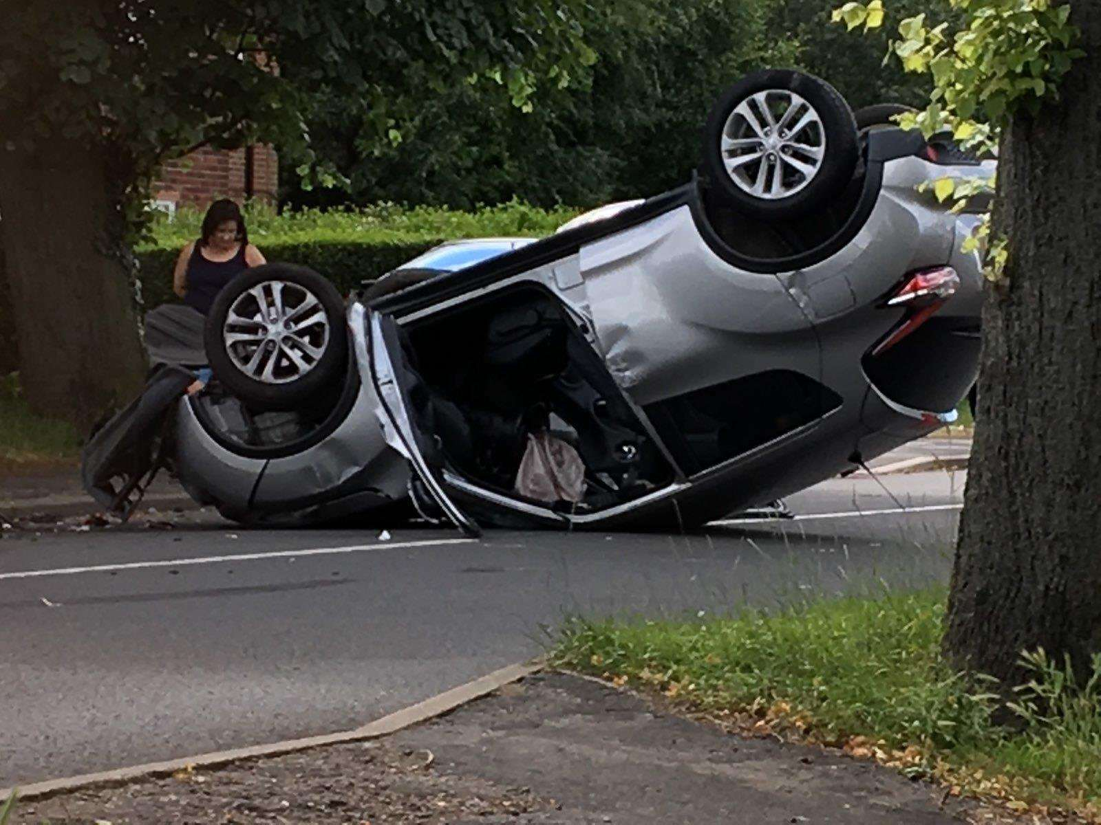 A car has overturned on Harrowby Lane following a collision. (2668568)