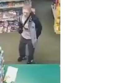 CCTV footage show the man believed to have stolen a charity box from South Witham Village Shop.