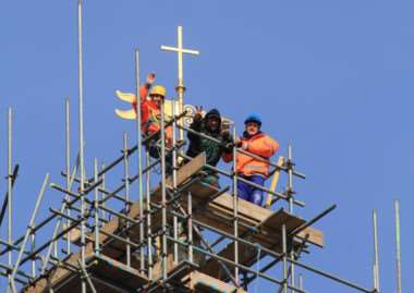 Steeplejacks place the weathervane atop the spire of St Wulfram's Church in Grantham. Photo: Roger Graves