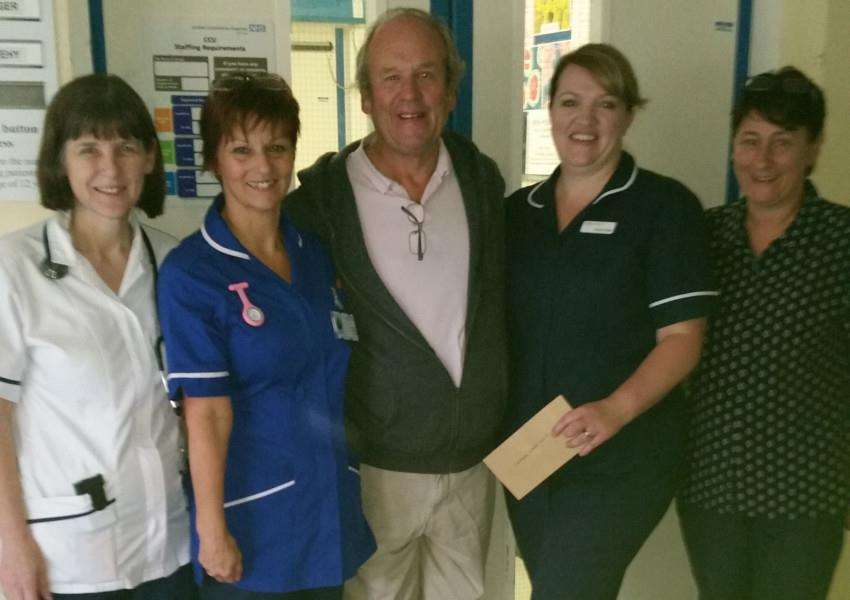 Paul Turner presents a cheque to Grantham Hospital for �500 after organising the Summertime Special at Grantham College.