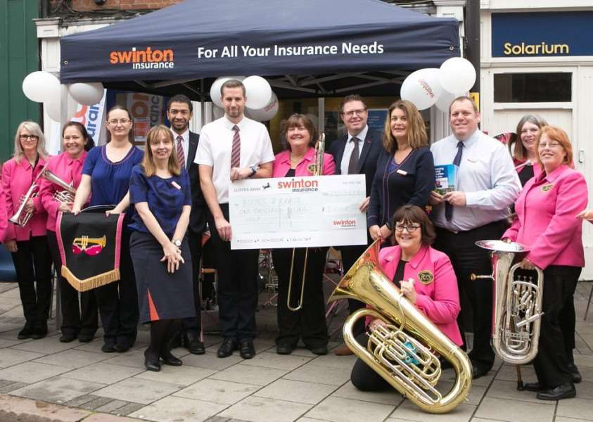Swinton Insurance presented brass band, Boobs & Brass, with �1,000 as part of their 60th anniversary.