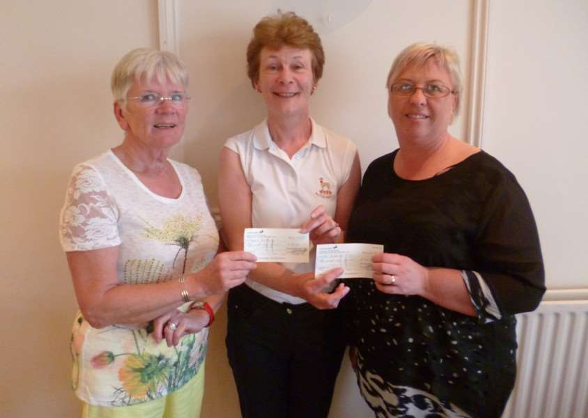 Margaret Barkway and Julie Gooderson receive winners cheques from Belton Park lady captain Sheila Mason.