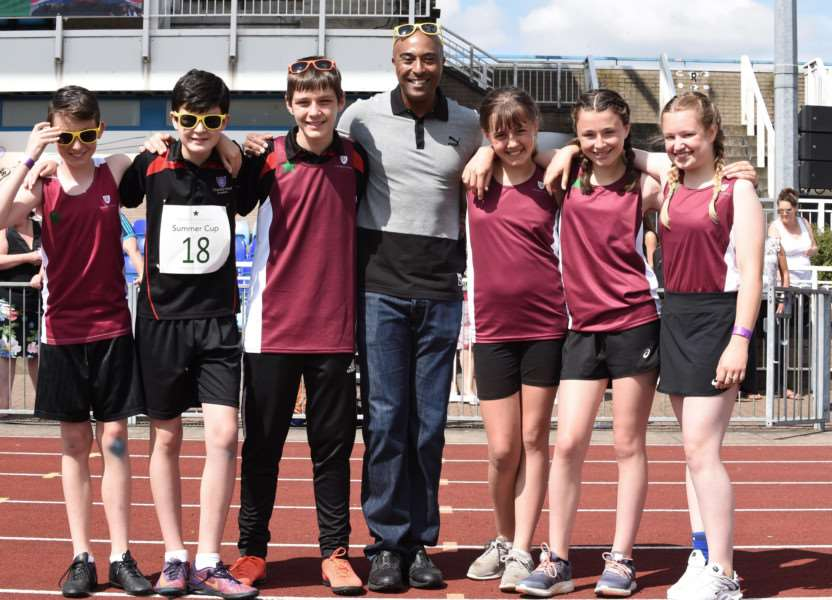 Colin Jackson with pupils from Charles Read Academy at the Summer Cup held at The Meres in Grantham.
