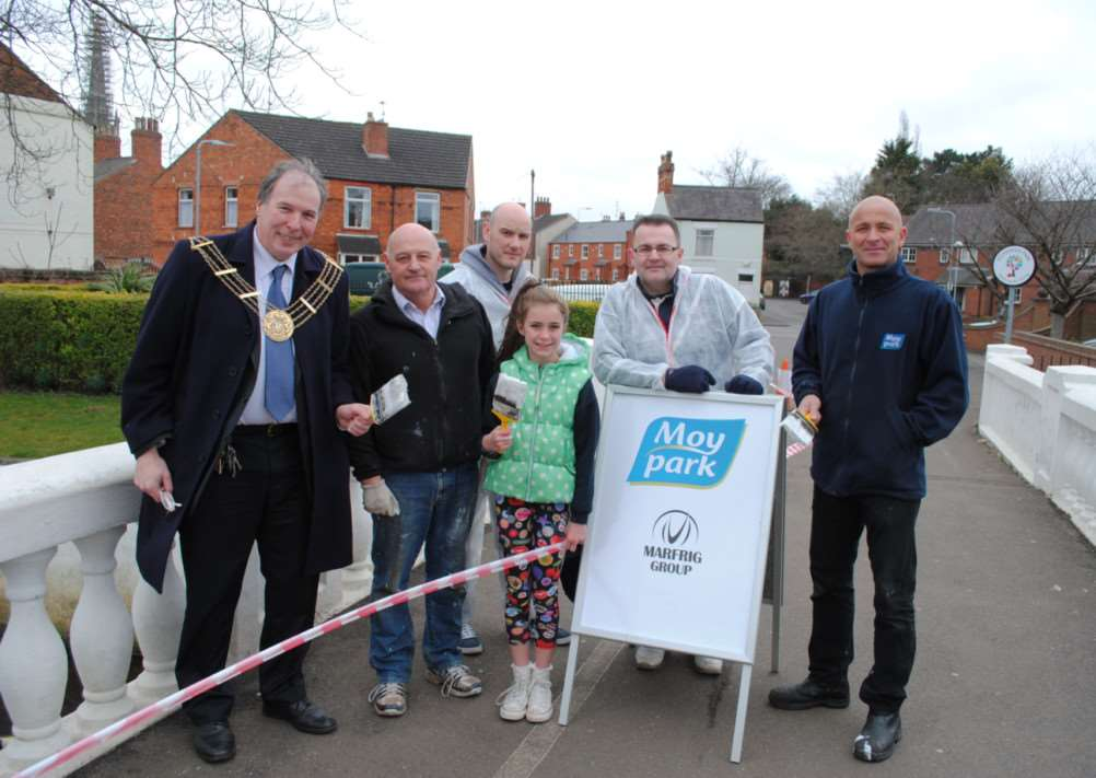 On the White Bridge are, from left, Mayor of Grantham Ian Selby, Bruce Vinson, Antony Leone, Isabella Foss, Darren Abbott and John Foss.