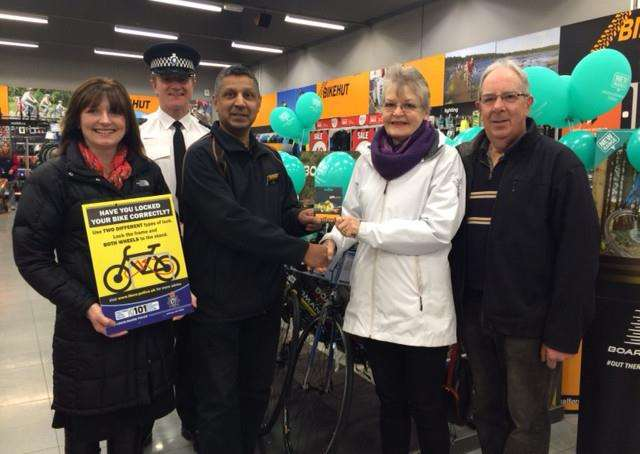 From left - crime reduction tactical advisor Sally Picker, Inspector Gary Stewart, Halfords store manager San Patel, Mrs Winters and her husband.