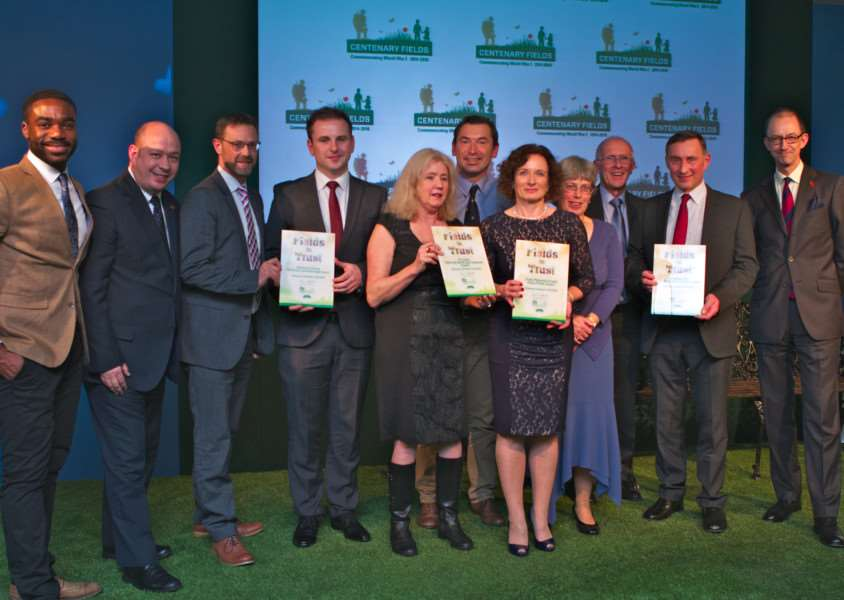 Picking up the award among the Fields In Trust winners were Wyndham Park Forum secretary Elizabeth Bowskill, fourth right, chairman John Knowles, third right, and SKDC's Grounds Maintenance Co-ordinator Steve Frisby, second right. Photo: Rich Merritt, Flux