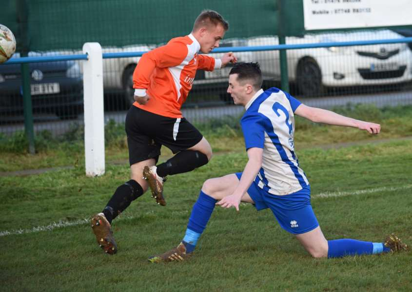 Harrowby United defender Sam Weatherstone tussles with a Yaxley opponent. Photo: Toby Roberts